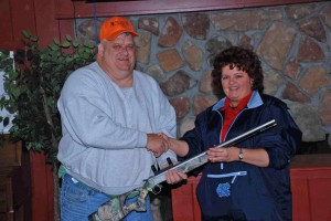 Janet Harmon of Van Products awards a CVA 50 cal Muzzle Loader for the biggest doe to Gene Hildebran