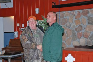 Rick Morrow receives his trophy for the biggest Buck from Karl Reichardt