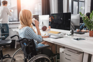 Woman in Wheelchair in Office